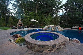 Raised Spa next to in ground pool.